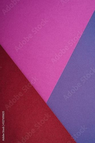 Paper triangle geometric texture in red, purple and blue colors - 327610635