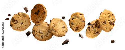 Obraz na plátně Flying Chocolate chip cookies with pieces of chocolate isolated on white background
