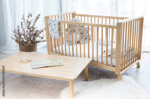 Fotografie, Obraz baby wood bed and table with mattress kid pillow dolls