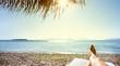 Leinwanddruck Bild - woman feet in sunbed on the beach