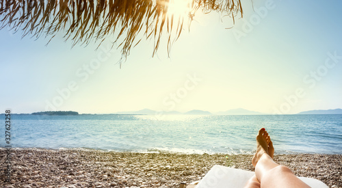 woman feet in sunbed on the beach Canvas Print