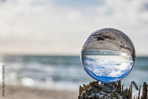 lensball at the beach - look through a lensball at the baltic sea - photography accessories #327630055