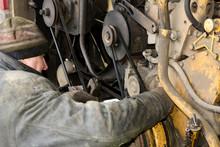 Locksmith Repairs The Motor Of The Bus.
