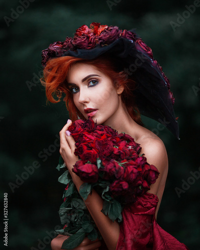Obraz na płótnie Portrait of amazing pretty young woman with fiery red hair wearing hat made of r