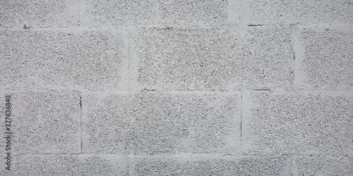 Grey brick cinder block wall background concrete tile cladding seamless texture