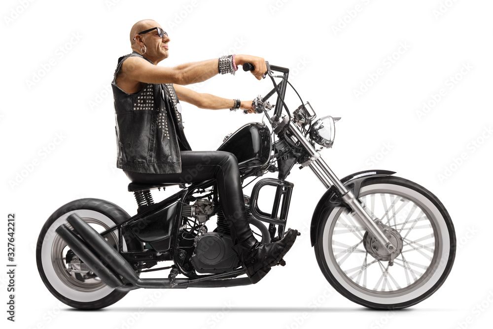 Fototapeta Bald biker riding a custom chopper motorbike