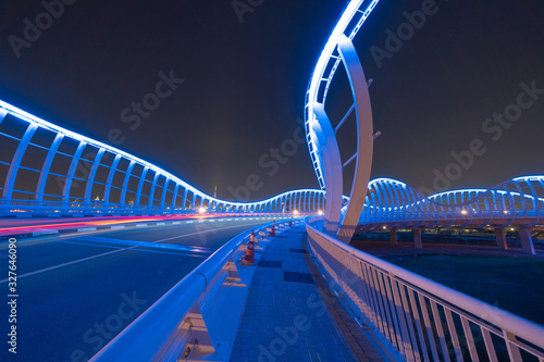 Meydan Bridge and street road or path way on highway with modern architecture buildings in Dubai Downtown at night, urban city at night, United Arab Emirates or UAE Canvas