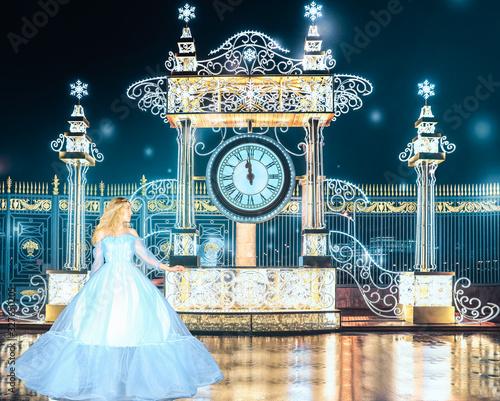 Fototapeta Beautiful princess in blue long dress runs away from the queens ball when the clock is struck 12pm