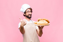 Young Crazy Baker Man Holding ...