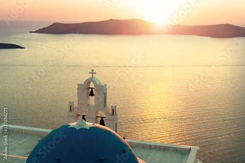 Photo 3 bells of Fira Santorini in sunset silhouette