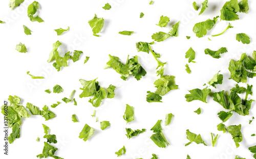Fototapeta Fresh sliced up green parsley leaves isolated on white background, top view  obraz