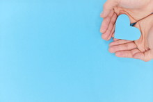 Hands Holding A Blue Heart In ...