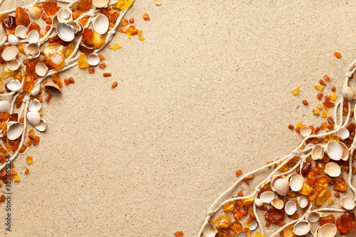 Ambers And Seashells On Sea Sand Background Fototapeta