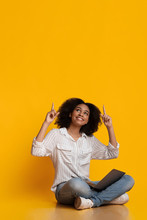 Excited Black Woman Sitting Wi...