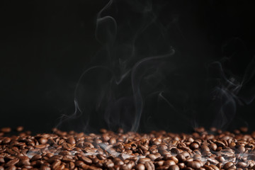 Many coffee beans on dark background