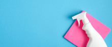 Cleaner Spray Bottle And Pink Rag On Blue Background. Cleaning Service Banner Mockup. Housecleaning And Housekeeping Concept. Flat Lay, Top View