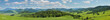 Leinwandbild Motiv Large panoramic view of the spring landscape, countryside. Green forests and meadows, blue sky with white clouds.