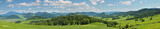 Fototapeta Fototapety z naturą - Large panoramic view of the spring landscape, countryside. Green forests and meadows, blue sky with white clouds.