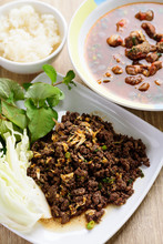Traditional Northern Thai Food, Spicy Minced Pork Salad (Larb Moo Kua) And Spicy Thai Curry Soup With Beef Guts (Kaeng Om Nua) Eating With Sticky Rice