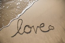 Text Love On The Sand On The B...