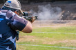 canvas print picture - selective focus of man holding and fire shotgun in shooting range of gun shooting competition