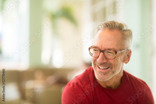 Obraz Mature handome fit man sitting outside stock photo - fototapety do salonu