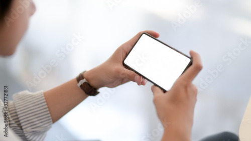Fotomural Cropped shot of businessman looking on  horizontal smartphone