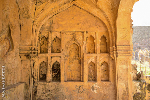 Old Historical Golconda Fort Ruined Walls in India Background stock photograph Wallpaper Mural