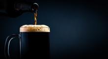 A Mug Of Black Beer Pouring Fr...