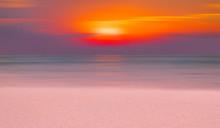 Calm Sea And White Beach At Sunset