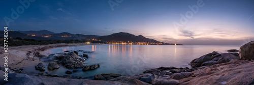 Night falling over beach and village of Algajola in Corsica Canvas-taulu