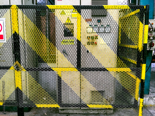 High voltage power control cabinet, Yellow safety fence in factory area, Safety Canvas Print