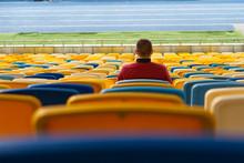 Spectators Watch Football In A...