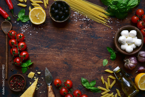 Photographie Traditional ingredients of italian cuisine : pasta, cheese,tomatoes,garlic,olive oil, basil and lemons