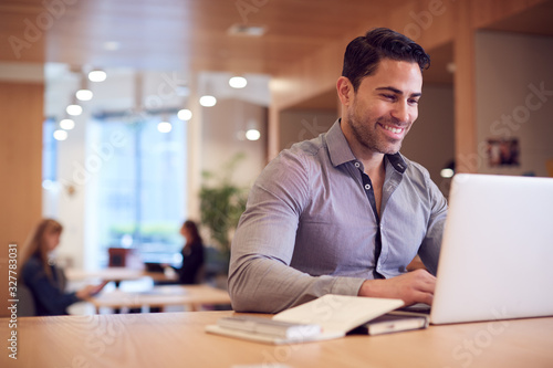 Valokuva Businessman At Desk In Modern Office Work Space With Laptop
