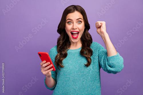 Obraz na plátně Photo of pretty lady hold telephone hands raise fist up celebrating crazy number