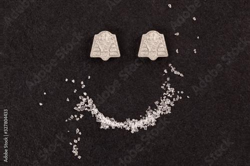Photo MDMA crystal and ecstasy pills.