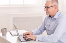 Happy Senior Man Using Laptop ...