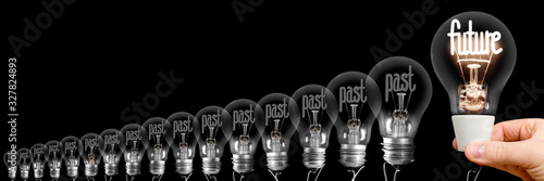 Foto Light Bulbs with Past and Future Concept