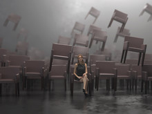 Lonely Woman Among The Flying Chairs