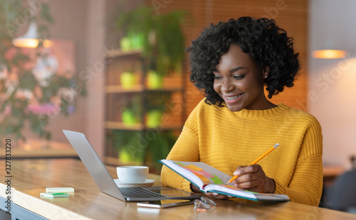 Fototapeta Enthusiastic student girl looking for job online, using laptop obraz