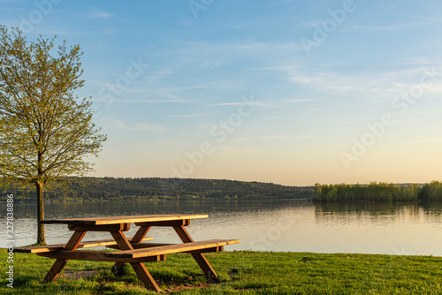 bench on the lake Canvas Print
