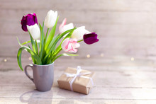 Spring Flowers And Gift Box At...