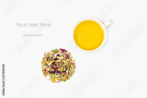 Layout of cup of green tea with assortment of different dry tea leaf and flower petals on a white background Fototapet