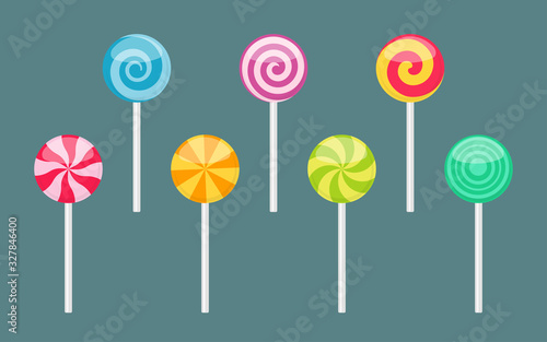 Fotografie, Obraz Set of lollipop sweet colorful candies with spiral and ray patterns
