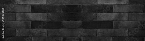 Fototapeta Black anthracite gray natural stone tiles masonry wall texture background banner obraz