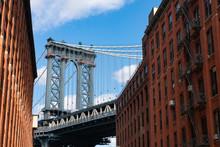 The Manhattan Bridge Between Old Red Brick Buildings In Dumbo Brooklyn New York