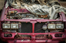 Old Pink Pickup Truck Abandoned In Wasteland, Car Covered With Old Rags, Car Scrap