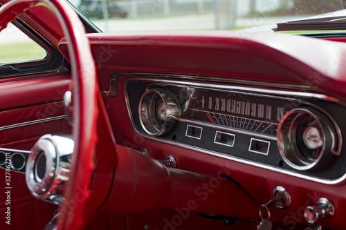 Fotografie, Obraz American Classic Dashboard in antique muscle car. Red interior.