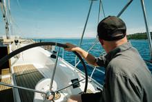 Male Skipper On The Steering W...
